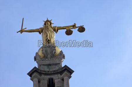 statue of lady justice with sword