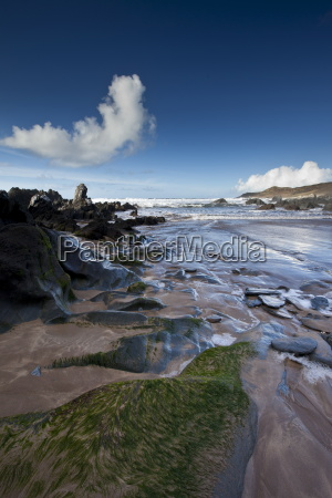 waves lapping onto the beach at