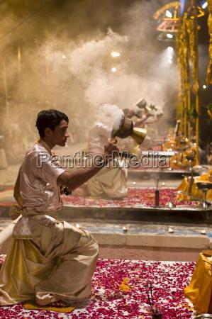 hindu priests at sundown aarti ritual