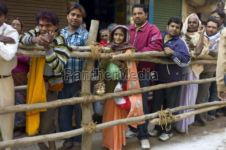 indian hindu pilgrims queue to visit