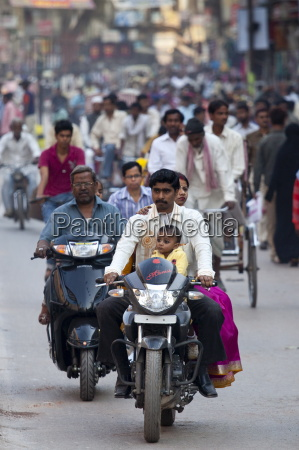 fathers with children on cycles in