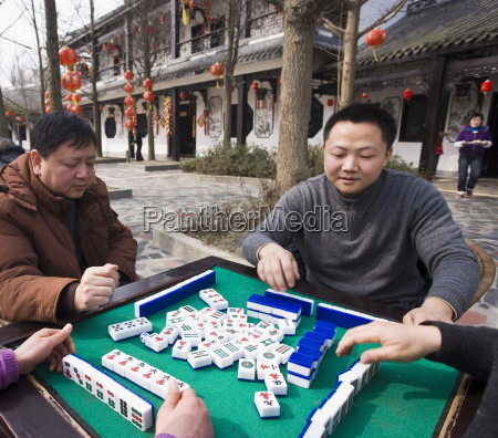 chinese men playing traditional game of