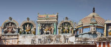 hindu religious icons above hindu temple