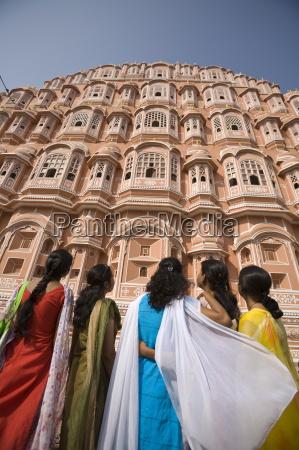 women in traditional dress standing in