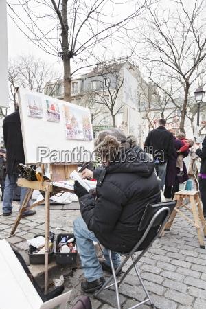 painter at the art market at