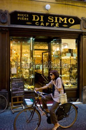 cyclist passing di simo caffe ricci
