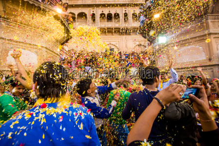 crowd throwing flower petals during the