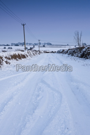 country lane in deep snow in
