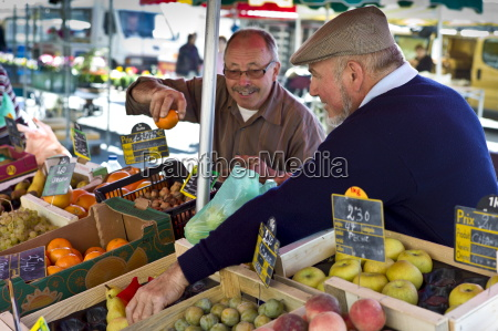 frenchmen working on fruit staff