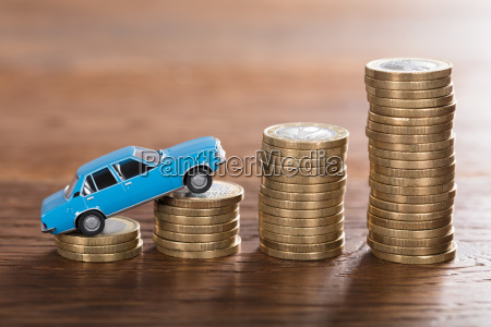car model on stacked coin