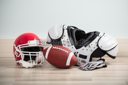 sport equipments on hardwood floor