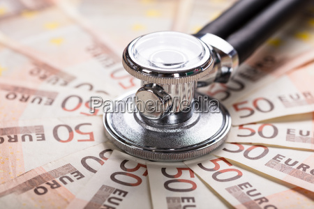 stethoscope on euro banknote