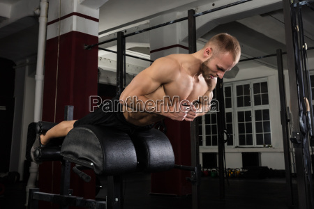 man doing core exercise on exercise