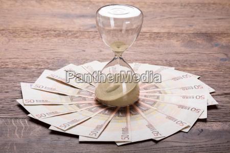an hourglass on euro notes
