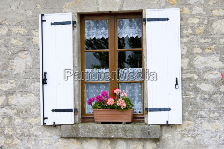 typical french window with lace curtain