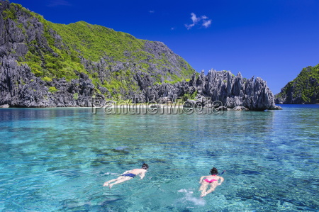 tourists swimming in the crystal clear
