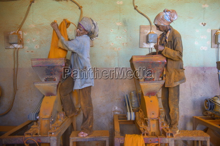 women working in a berbere red