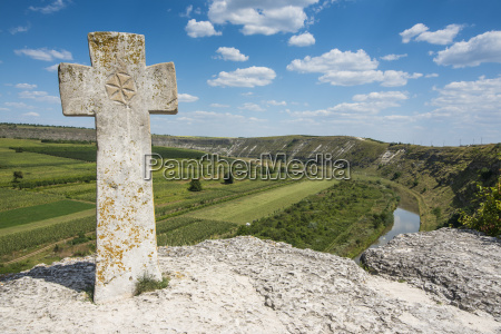 old christian cross above the historical