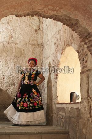 hispanic woman wearing a traditional dress