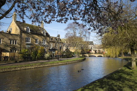 cotswold stone cottages along the river