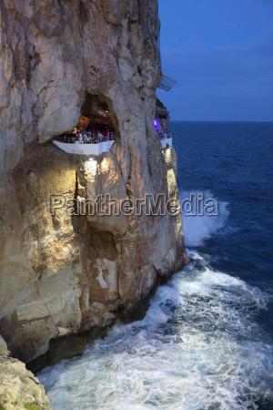 bar built in cliff caves cova