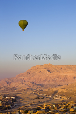 hot air balloon suspended over the