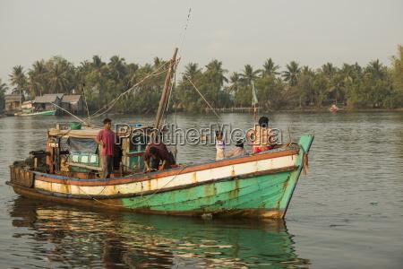 dawn at kampot harbour as fishing