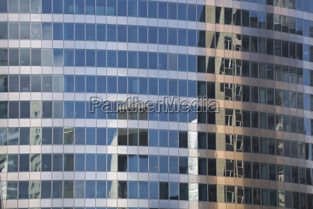 buildings reflecting in a building in