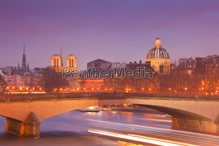 the city of paris at dusk