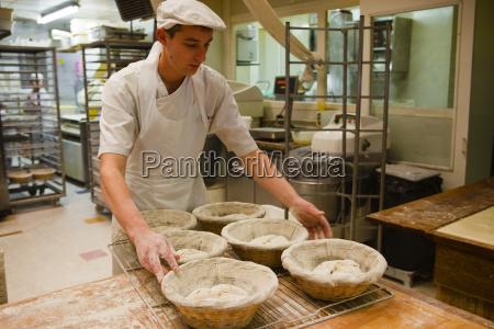 a baker prepares dough ready to