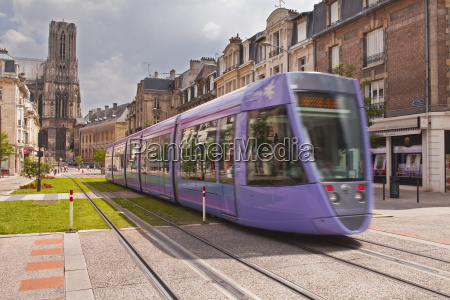 a tram passes in front of