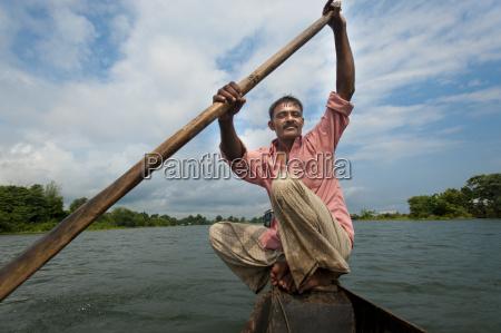a fisherman on kaptai lake chittagong