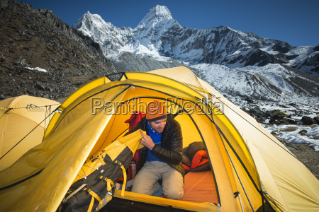 a mountaineer packs his bag in