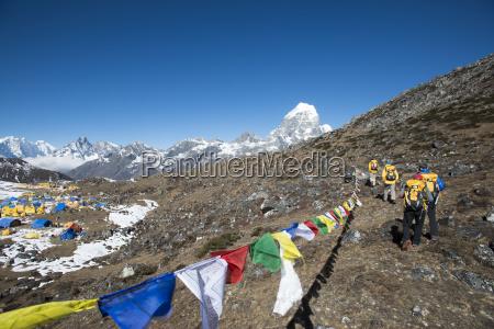 a team of four climbers return