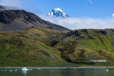 snow capped mountain breaking through the