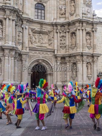 masked dancers fiesta de la virgen