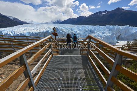 two visitors at perito moreno glacier