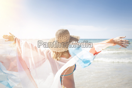 beautiful woman enjoys the beach