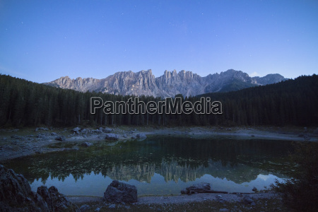 latemar mountain range and woods are