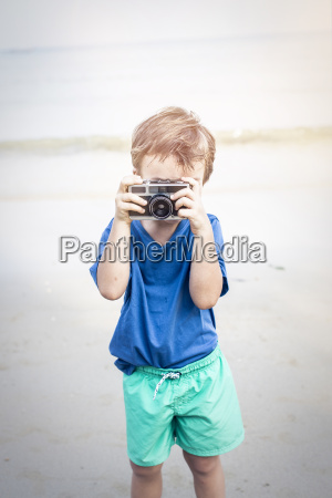 cute little boy making some photos