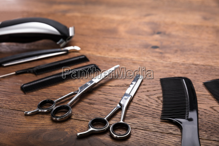 hairdresser tools on wooden desk