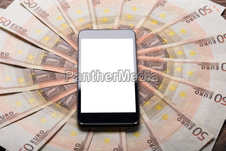 mobile phone on euro note