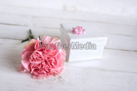 pink flower decoration with a gift
