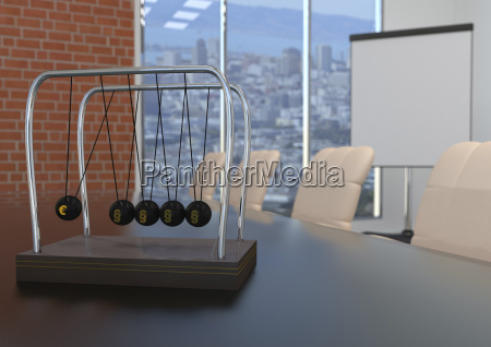 newtons cradle with euro symbol and