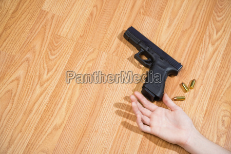 womans hand lying on floor with