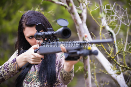 usa texas young woman aiming with