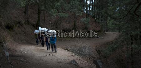 nepal himalaya khumbu trekkers crossing a