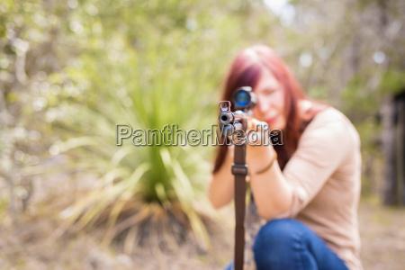 usa texas young woman aiming hunting