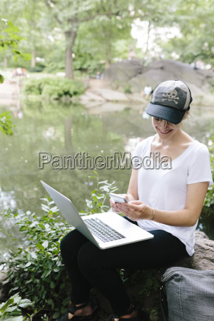 young woman sitting at lakeside in
