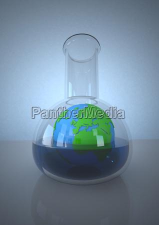 planeten erde im laborkolben vor blauem